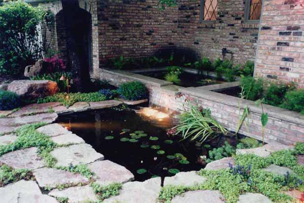 Koi pond entry garden niwa design studio ltd for Concrete koi pond design